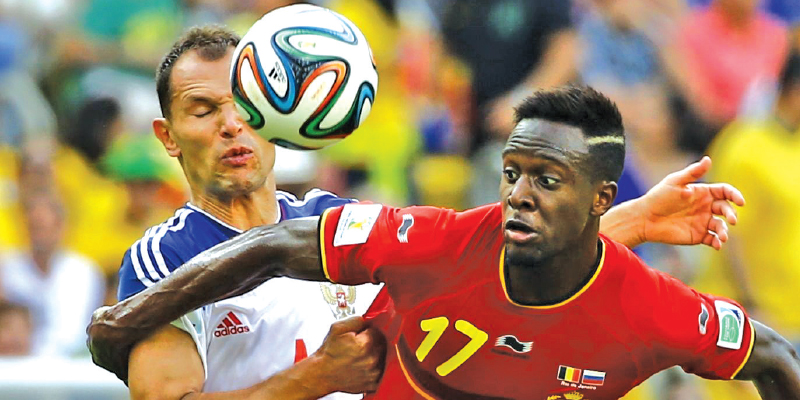 russias-sergey-ignashevich-left-fights-for-the-ball-with-belgiums-divock-origi.jpg